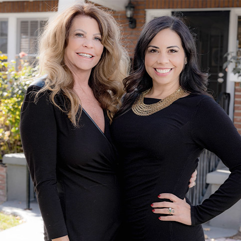Terry Rasner and Sarah Carmona Zink standing side by side, the mother and daughter team of Dreams Foundation Inc.